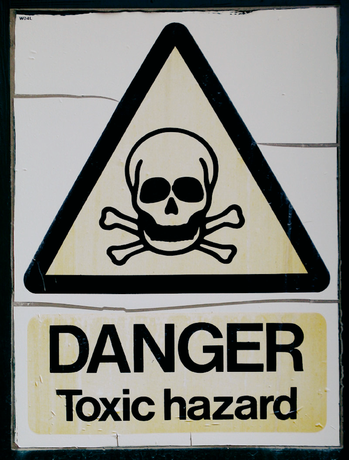 Sign with a skull illustration that reads DANGER Toxic Hazard.