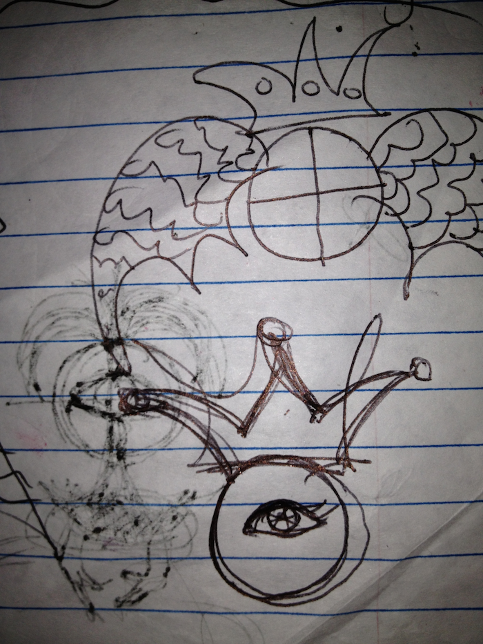 A photo of sketches on slightly crumpled notebook paper. At the bottom, it shows an image of an eye within a circle, on top of which is a crown. At the top, a circle with two lines at a crossroads within it is adorned with textured wings and a crown. Sketches on the other side of the paer are dimly visible through the page.
