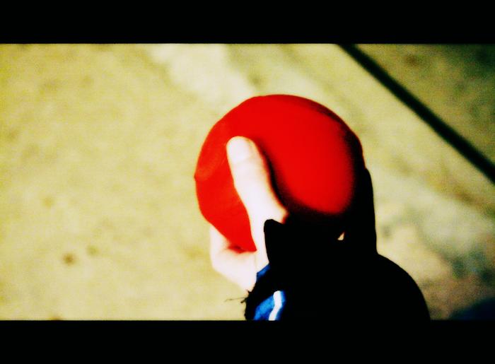 A hand holding a ball.