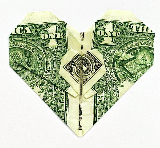 A heart created by folding a dollar bill.