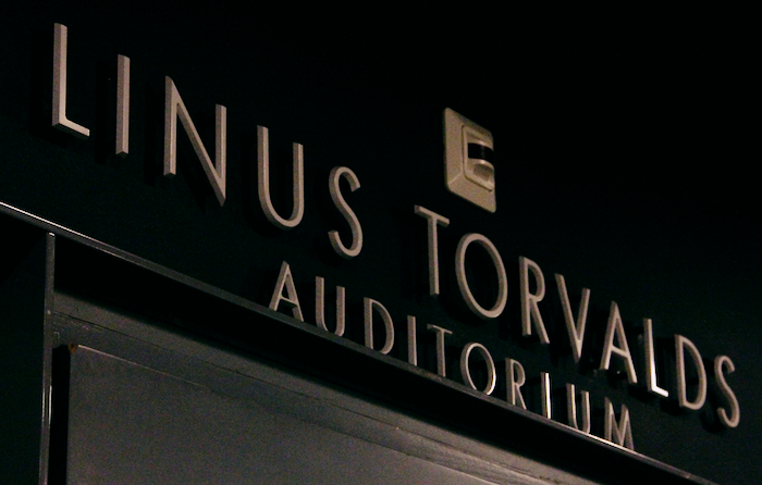 The top of an entryway reading 'Linus Torvalds Auditorium'.