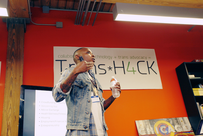 Portrait of the author presenting at a TransH4CK event.