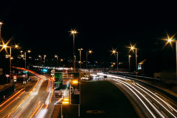 Cars on a highway at night.