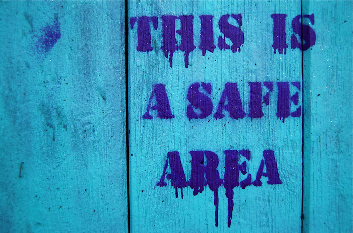 Sign that reads 'This is a safe area'.