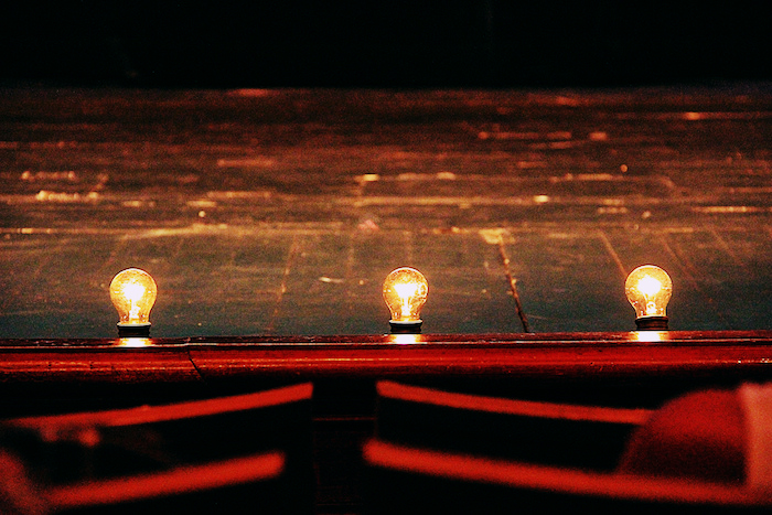 Light bulbs lining a stage.