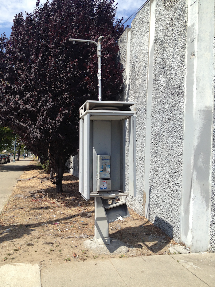 Image of an out-of-service phone booth.