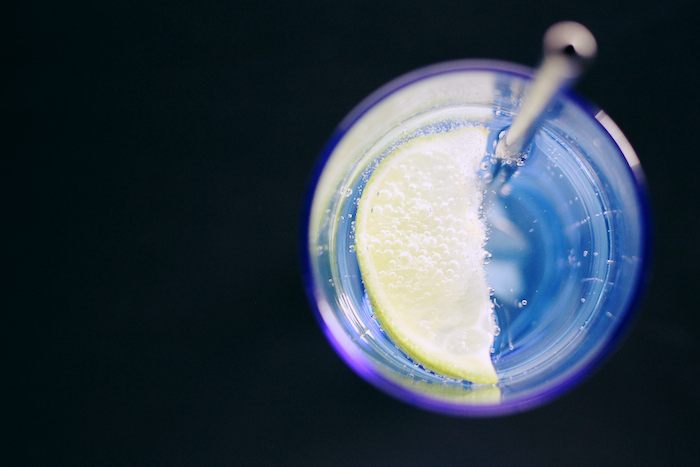 Close-up of a drink with a lemon slice.