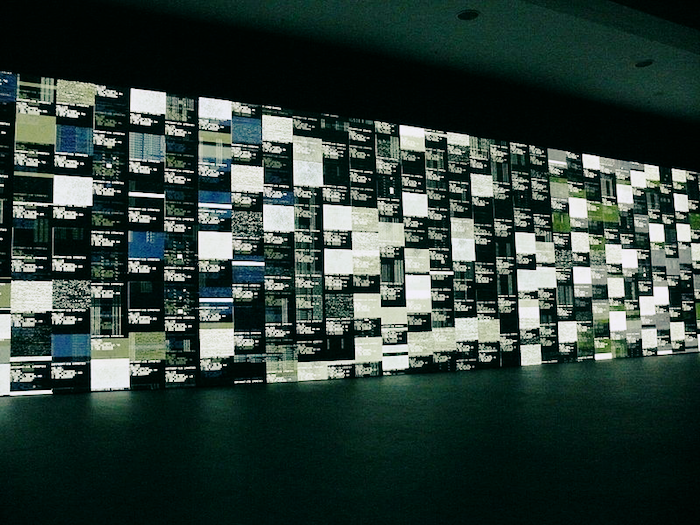 Dozens of screens displaying data.