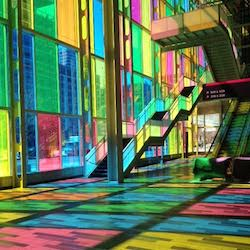 Anna's avatar - brightly colored windows with light streaming through.