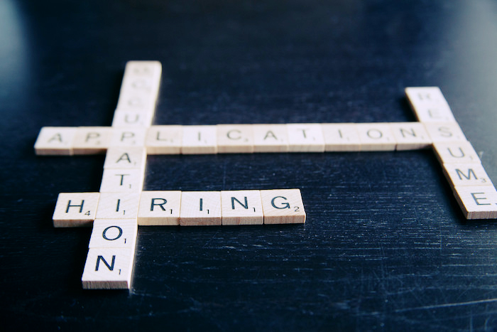 Scrabble game with hiring-related words including 'resume' and 'application'.