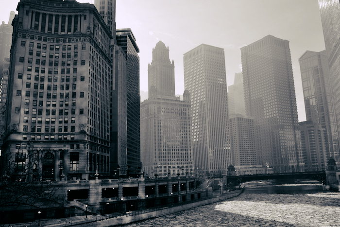 Photo of the Chicago River with buildings rising all around it.