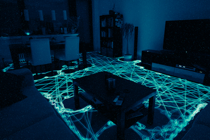 A living room with a grid of glowing lights across the floor.