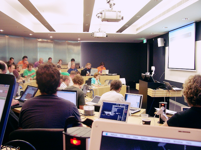 Computer science classroom , showing students with open computers.