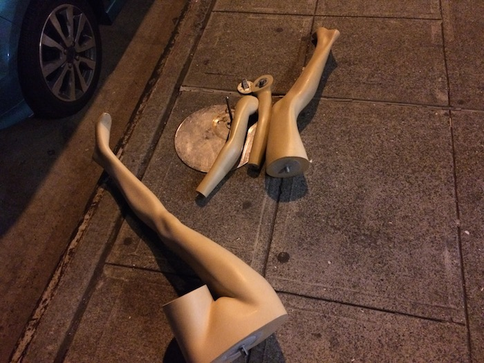 Pieces of a mannequin on a stage.