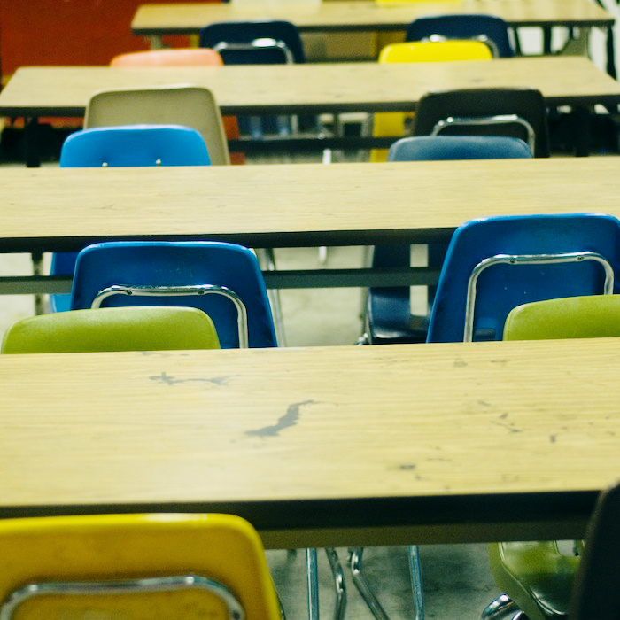 Desks and chairs in a classroom.