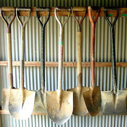 Avatar of El Gibbs, a series of shovels hanging on a rack.
