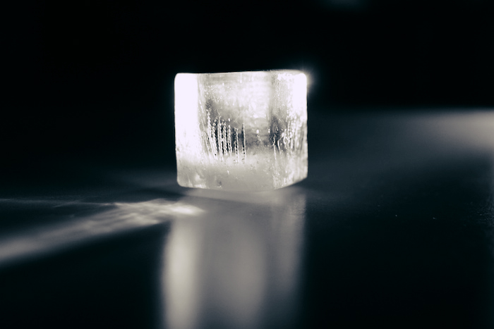 Ice cube with light shining through it.