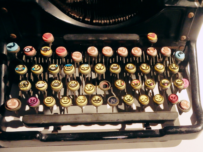 Typewriter with the keys replaced by emoji buttons.