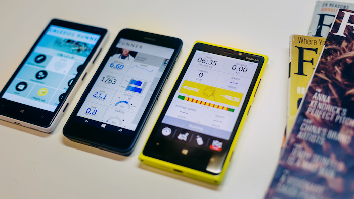 Series of fitness apps displayed on phones.