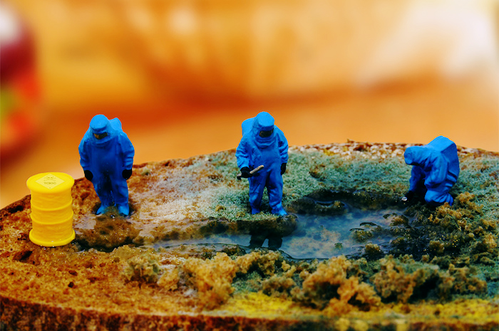 A miniature of a hazmat zone, with small figures dressed in containment suits investigating a spill.