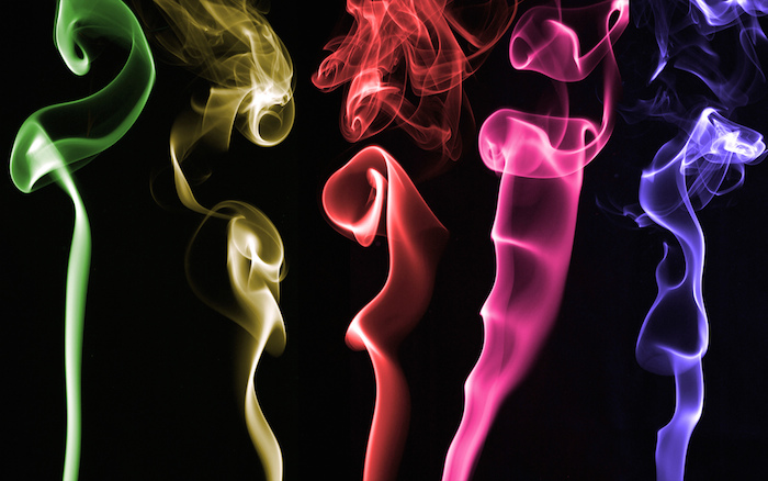 Rainbow-toned smoke coming from recently-extinguished candles.