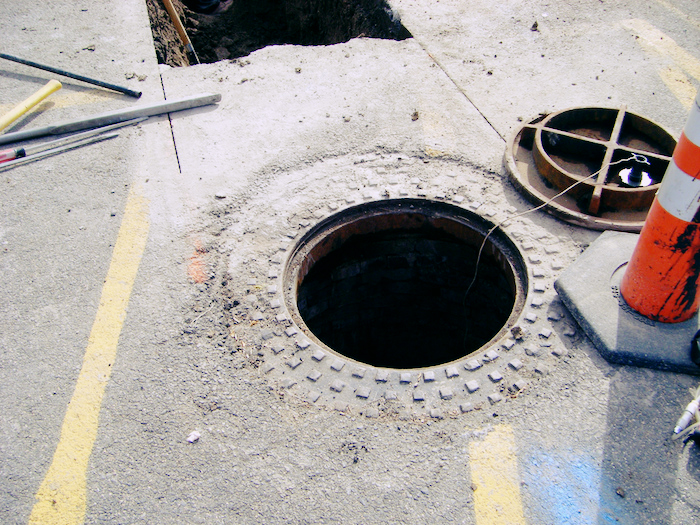 A utility hole in the street.