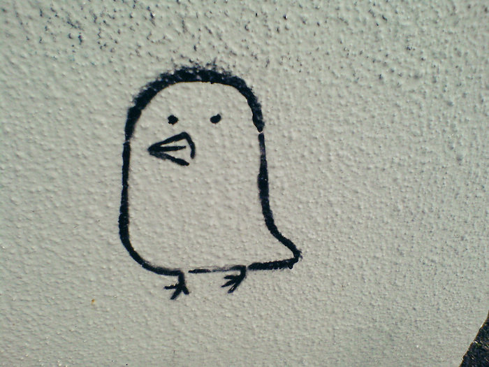 Small cartoon of a little bird.