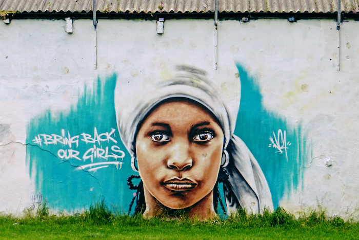 A mural for Bring Back Our Girls on the side of a building in West Vale. The mural depicts a kidnapped girl staring out at the viewer, and includes the Bring Back Our Girls hashtag.