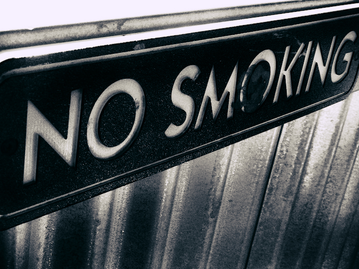 Severe-looking No Smoking sign.