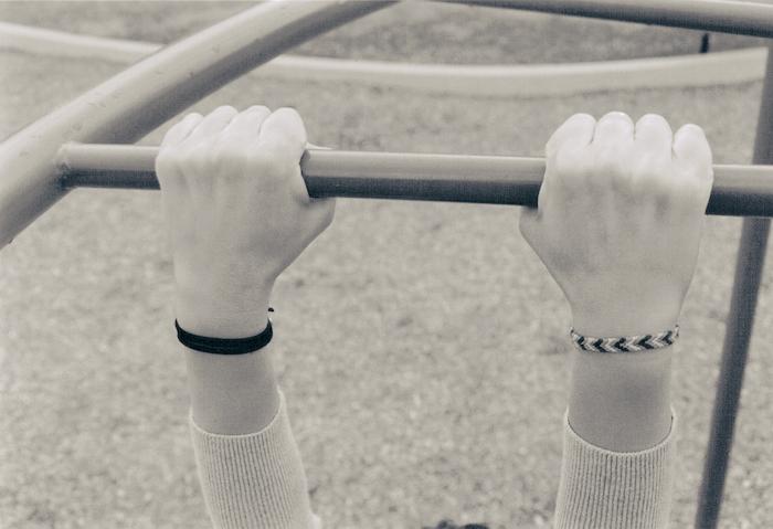 Hands on monkey bars.
