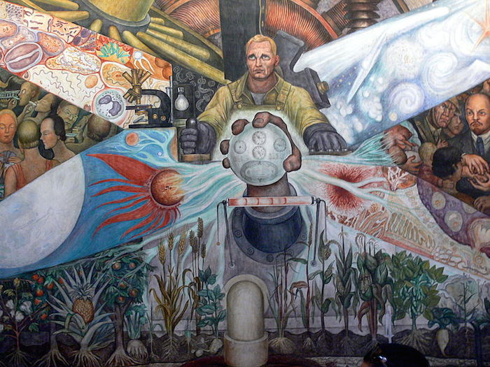 Painting of a man, holding a joystick and controls as if piloting an aircraft, at the crossroads of various mural imagery: at the base, growing crops; to the sides, depictions of machinery, gatherings of people. Propeller-shaped designs divide the imagery with decorations of the cosmos and cellular structures.