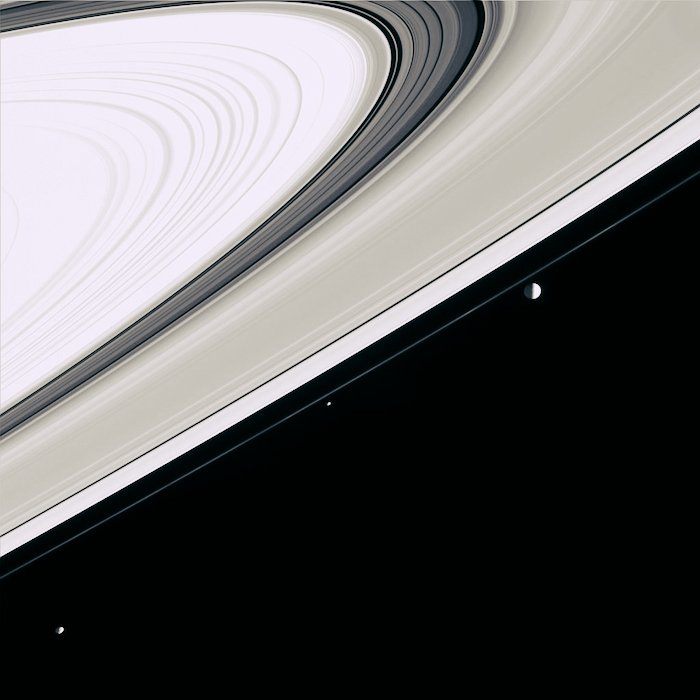 The moons Janus, Pandora and Mimas against Saturn's rings.