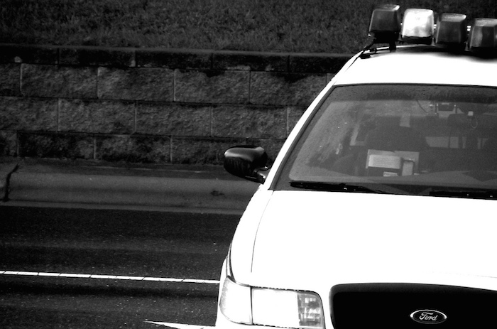 Black and white photo of a police car.
