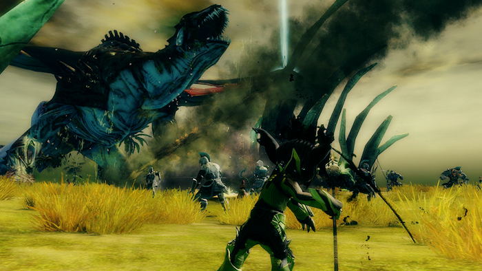 Characters fight a large dragon in Guild Wars 2.