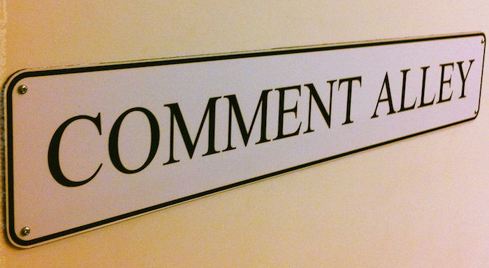 "Sign reading ""Comment Alley""."