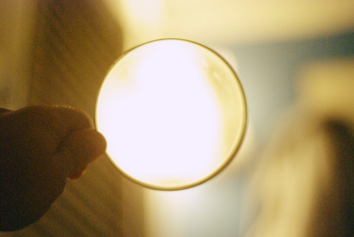 A magnifying glass held up to a light source.