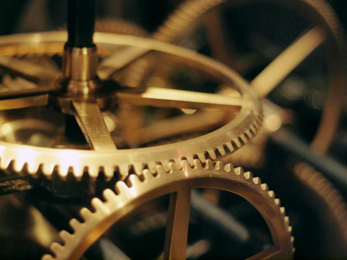 Bright metal cogs in a machine.
