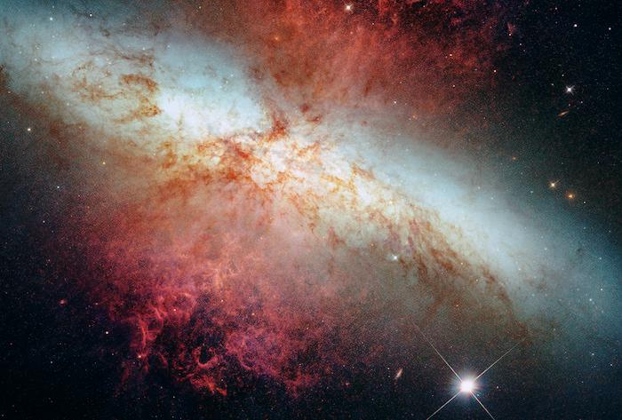 Image of a bright red supernova.