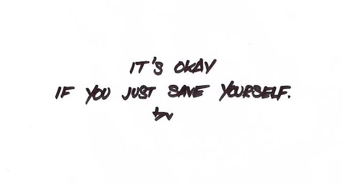 Hand-written sign reading 'It's okay if you just save yourself.'