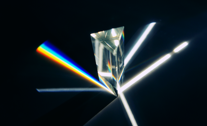 Prism reflecting intersecting points of light.