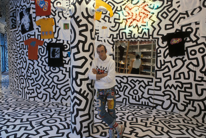 Photo of Haring at a gallery.