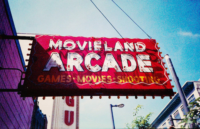"Vintage sign reading ""Movieland Arcade."""