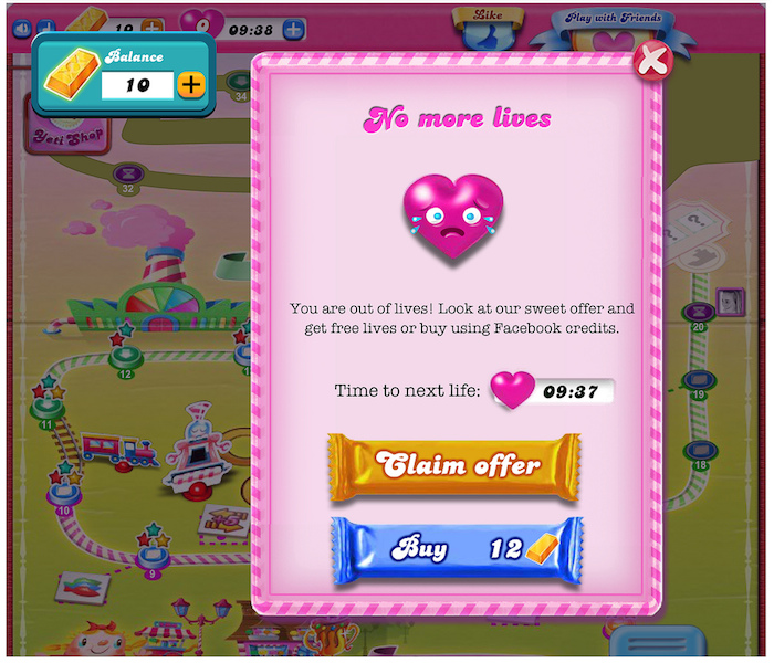 A Candy Crush microtransaction screen, requiring players to either wait to play again or purchase additional lives.