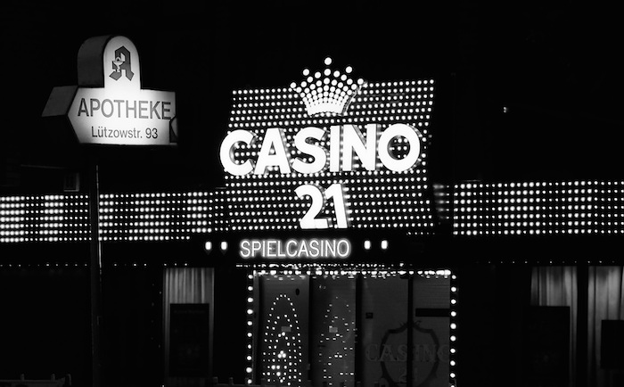 "A bright electric sign reading ""Casino""."