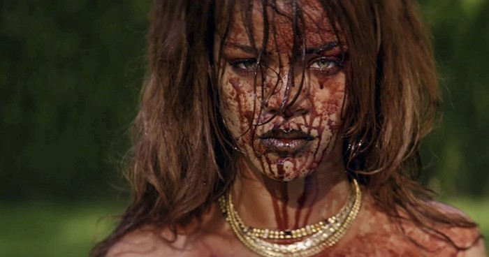 Still from Rihanna's BBHMM video: she is staring into the camera, blood covering her face.
