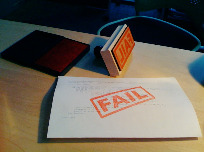 "A stamp that reads ""fail"" in red on a piece of paper."