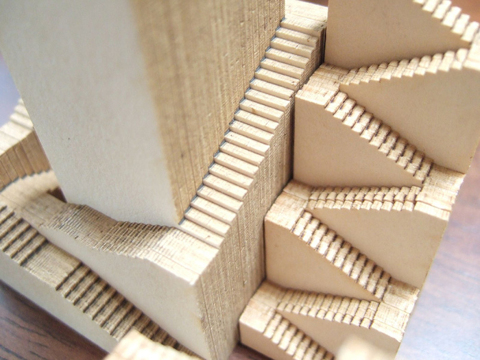 Wood, miniature cut-out of stairs.