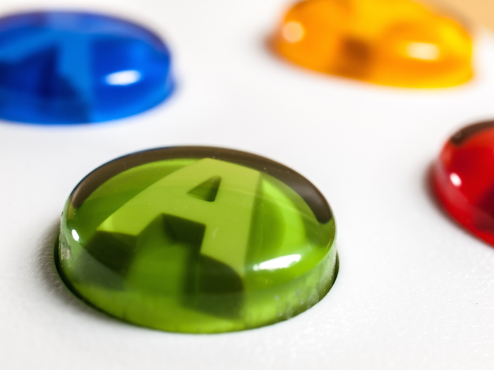 Close-up of the buttons on a video game controller.