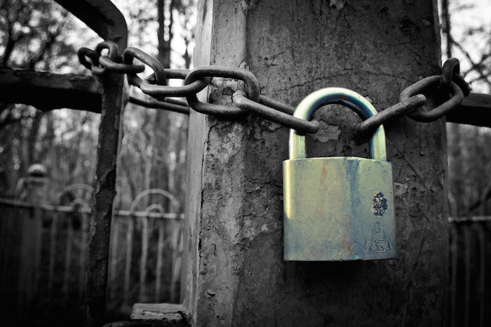 A lock on a chain around a post.