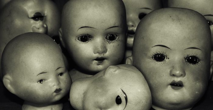Feminine doll heads.